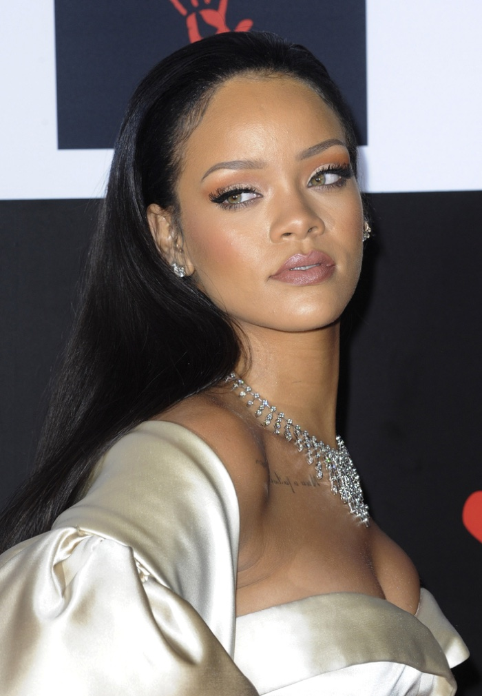 At the 2015 Diamond Ball, Rihanna wore a sleek and straight black long  hairdo. Photo: Tinseltown / Shutterstock.com