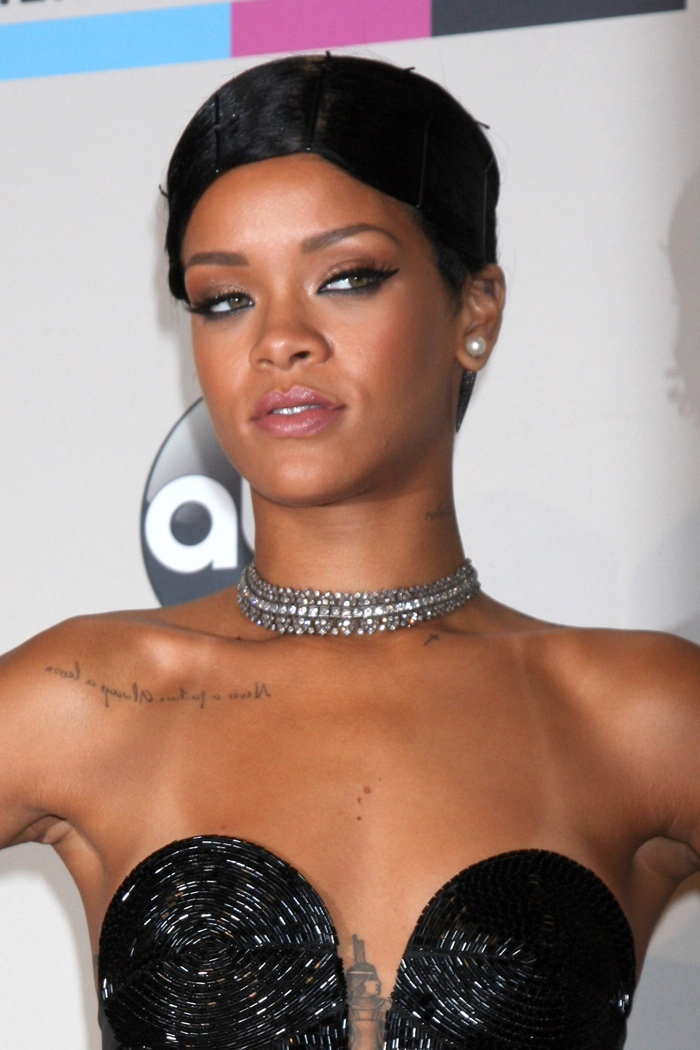 Rihanna gave a new twist to a short hairstyle at the 2013 American Music Awards by wearing bobby pins for a doobie wrap set. Photo: Everett Collection / Shutterstock.com