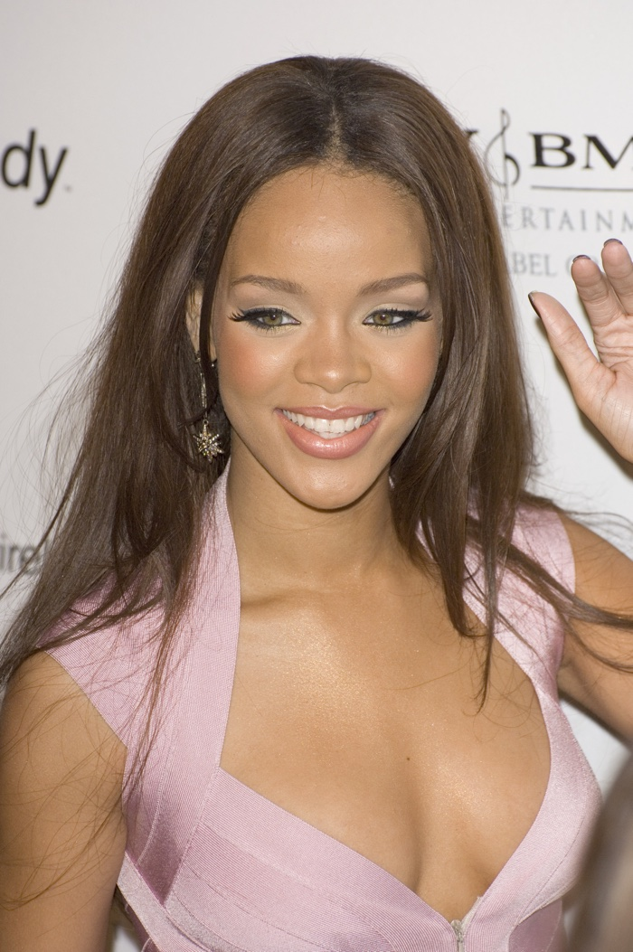 In 2007, Rihanna rocked a long and straight brown hairstyle at a pre-Grammy party. Photo: Featureflash / Shutterstock.com