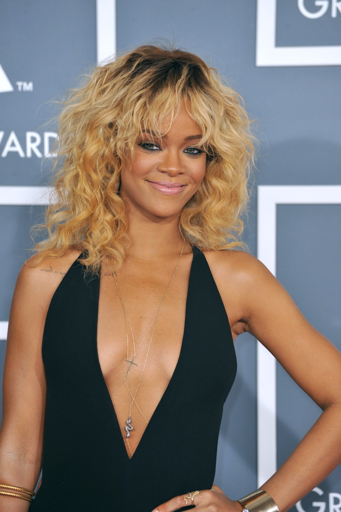 Rihanna showed off a wavy blonde hairstyle with bangs at the 2012 Grammys. Photo: Featureflash / Shutterstock.com