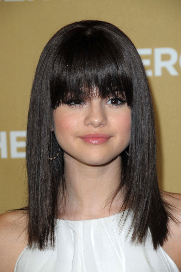 At the 2008 CNN Heroes event, Selena Gomez debuted blunt bangs with a ...
