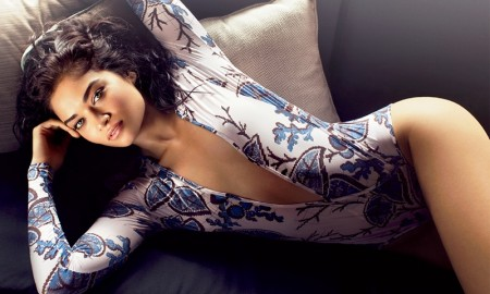 Shanina lounges in a Thakoon floral print bodysuit with a plunging neckline