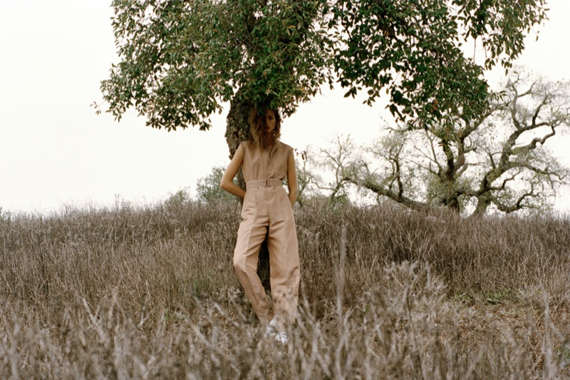 The model poses in nature wearing Hermes' latest designs