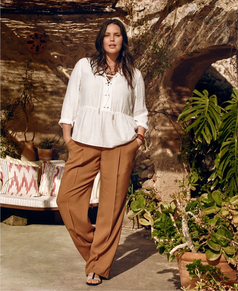 Candice models white blouse and brown trousers from Mango's plus-size collection, Violeta