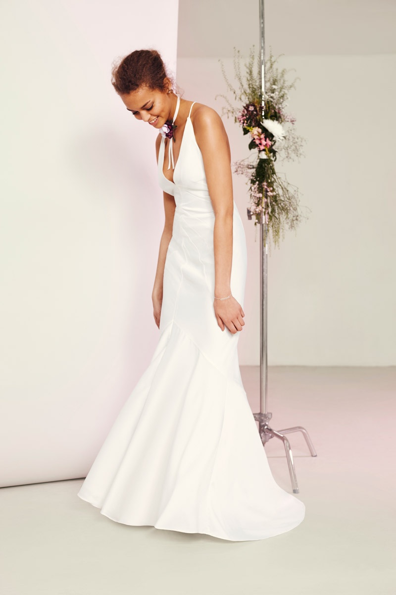 Model wears ASOS BRIDAL Deep Plunge Strappy Fishtail Maxi Dress