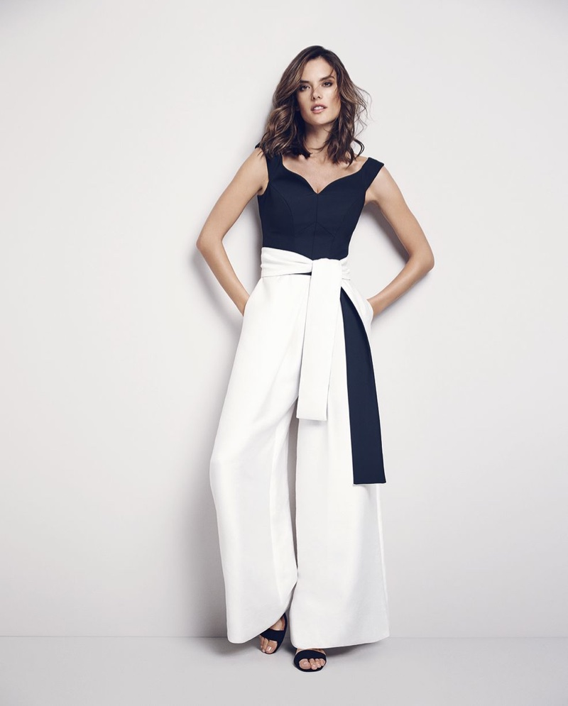 Alessandra Ambrosio poses in high-waist trousers and a top with a sweetheart neckline from Coast