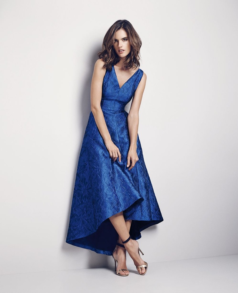Alessandra Ambrosio models a blue dress with asymmetrical hemline from Coast