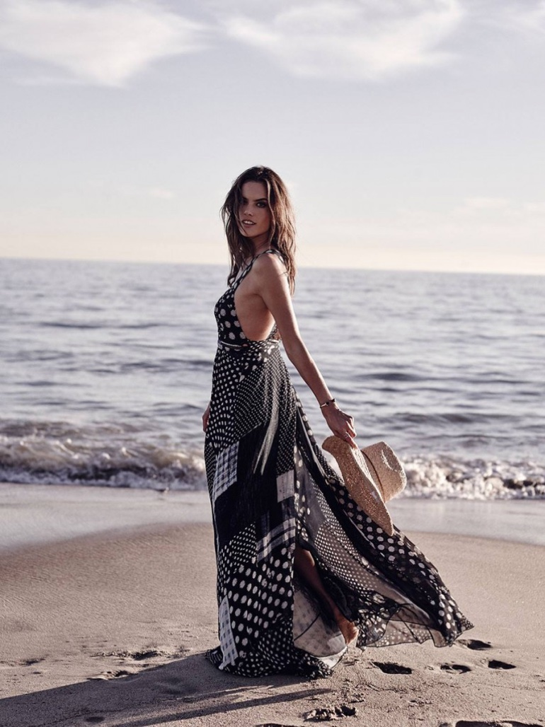 Walking on the beach, Alessandra Ambrosio models a black and white printed maxi dress