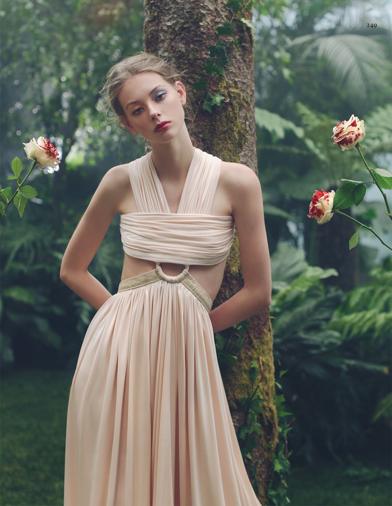 Posing next to floral blooms, Lauren models a Givenchy by Riccardo Tisci dress with pleating