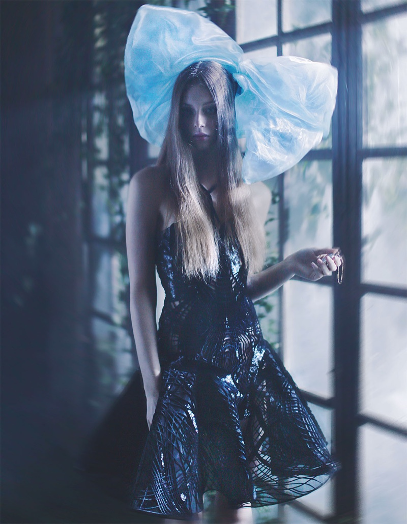 Lauren de Graaf gets mysterious in an Atelier Versace embellished dress and blue oversized bow by Simon Azoulay