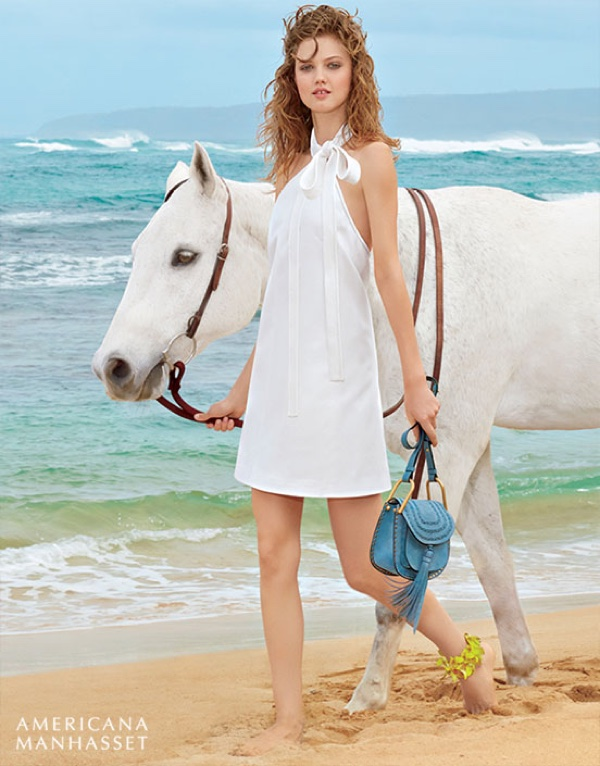 Posing for Americana Manhasset on the beaches of Hawaii with a horse, Lindsey wears a  white Chloe dress