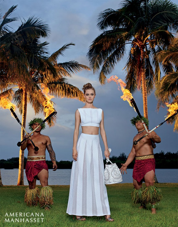 Lindsey Wixson poses next to Hawaiian flame throwers in a Giorgio Armani crop top and skirt
