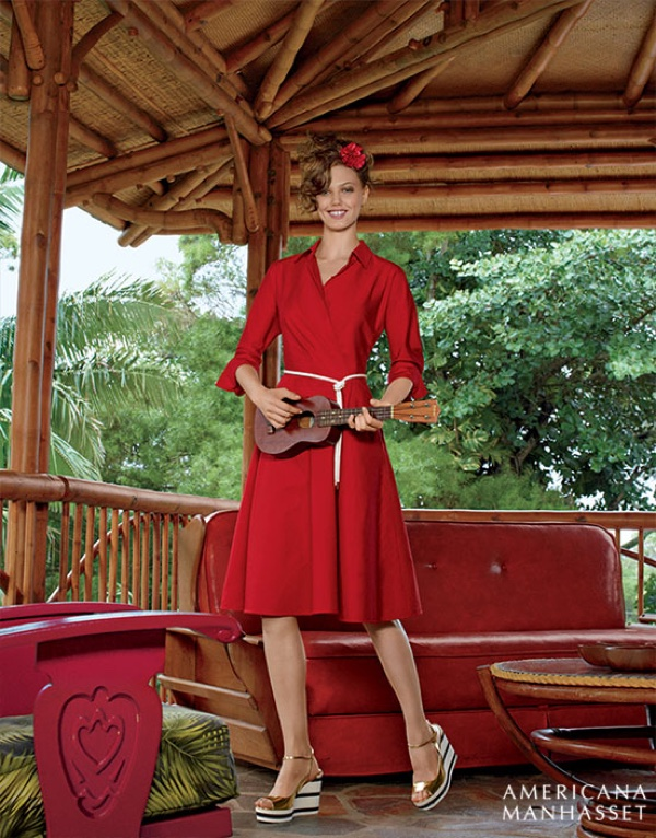 Playing the ukulele, Lindsey models Max Mara a-line dress in red