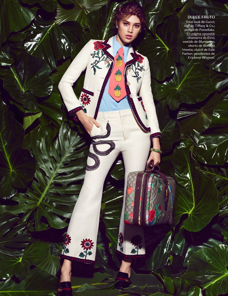 Anais Pouliot suits up in a Gucci pantsuit with floral and snake imagery