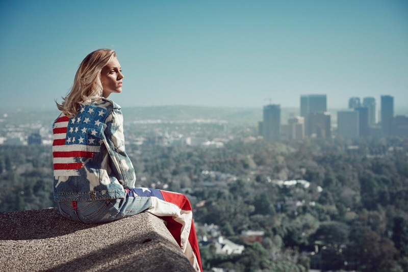 Looking over Los Angeles, Anja models a denim jacket and pants with American flag detail