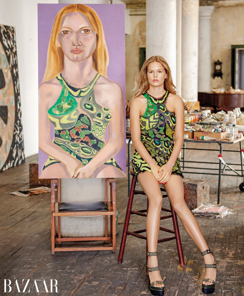 Anna Ewers poses next to Francesco Clemente portrait. Photo: Harper's Bazaar / Jason Schmidt