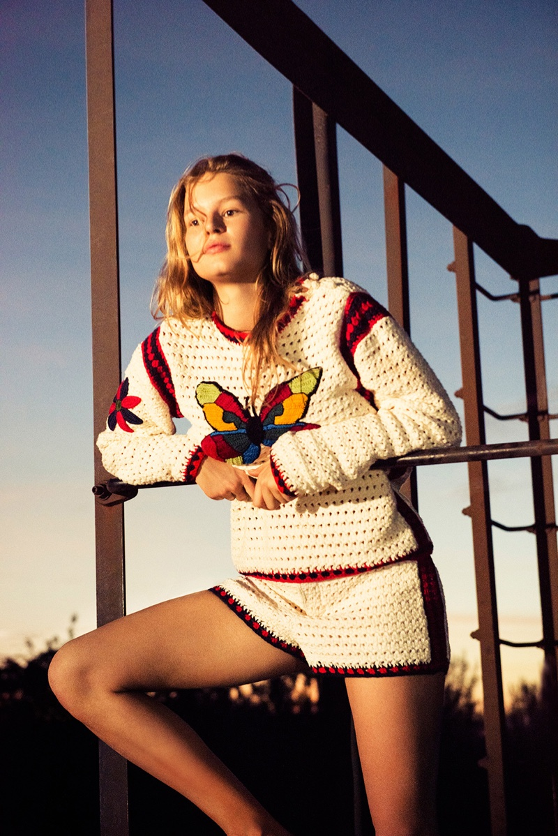 Soaking up the sun, Anna Ewers wears a butterfly sweater with matching shorts