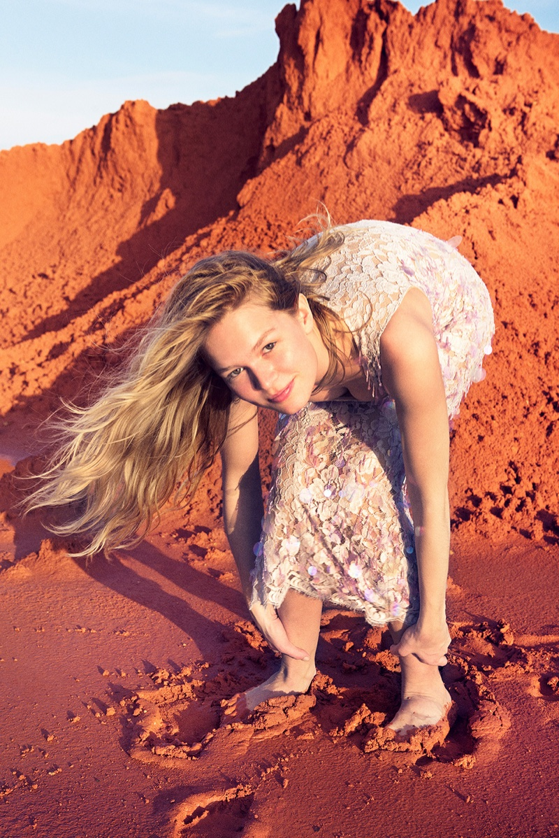 Photographed by Ryan McGinley, Anna Ewers poses in a Balenciaga lace dress