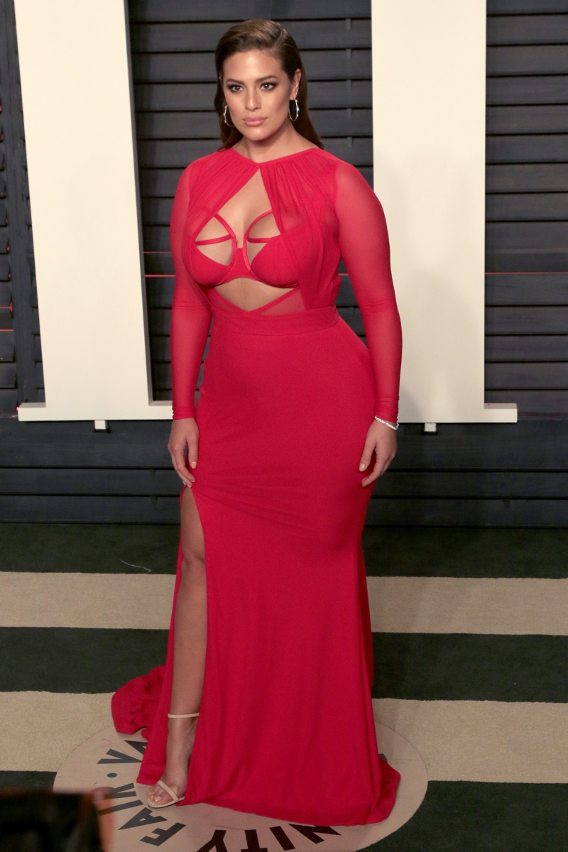FEBRUARY 2016: Ashley Graham attends the 2016 Vanity Fair Oscar Party wearing a red Bao Tranchi dress with cutout detail. Photo: Helga Esteb / Shutterstock.com