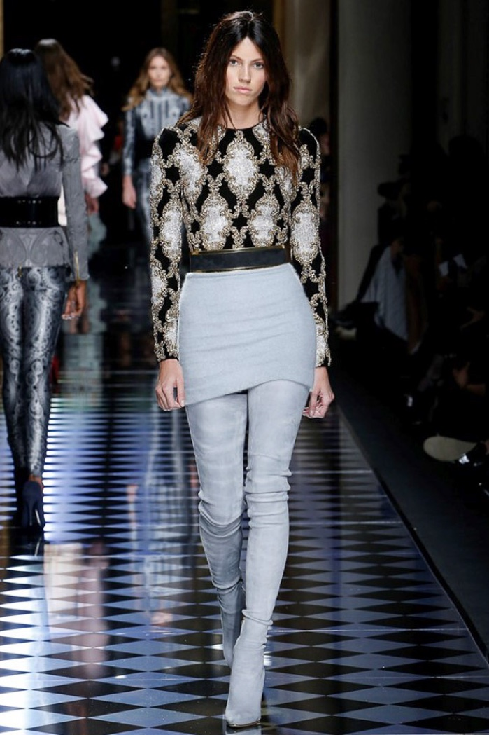 Devon Windsor walks the runway at Balmain's fall-winter 2016 show presented during Paris Fashion Week