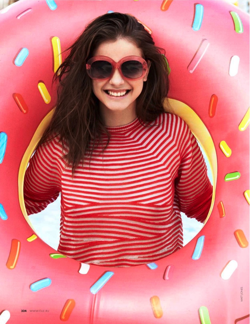 Wearing red framed sunglasses and a striped top from Giorgio Armani, Barbara is all smiles