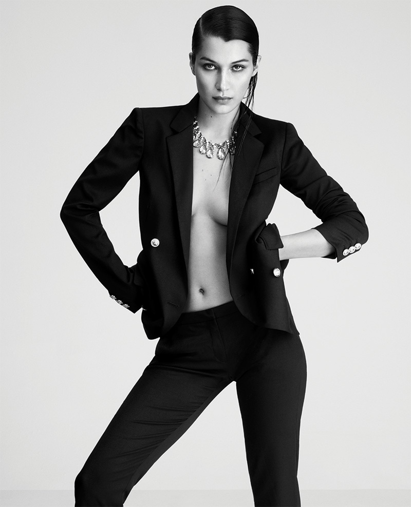 Photographed in black and white, Bella Hadid models Bulgari jewelry with a Versus Versace pantsuit
