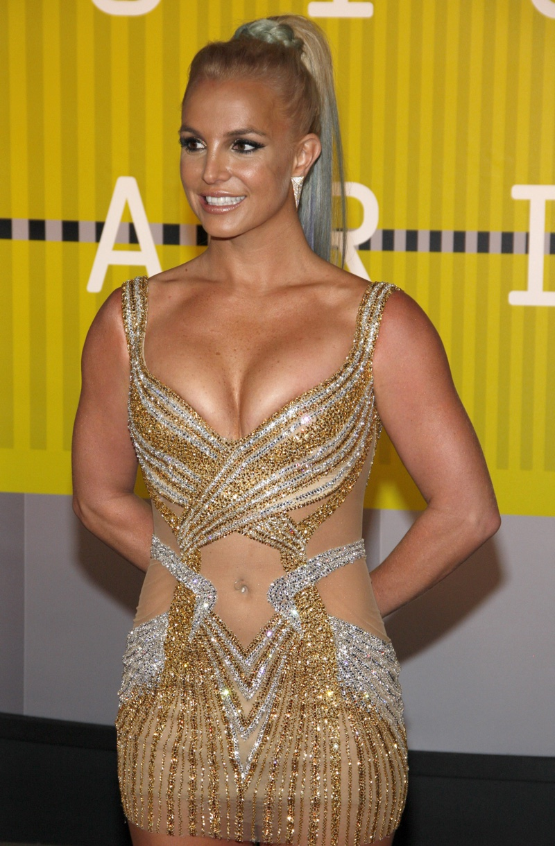 Britney spears attends the 2015 MTV Music Video Awards wearing a  Labourjoisie  gold dress and multi-colored ponytail. Photo: Tinseltown / Shutterstock.com