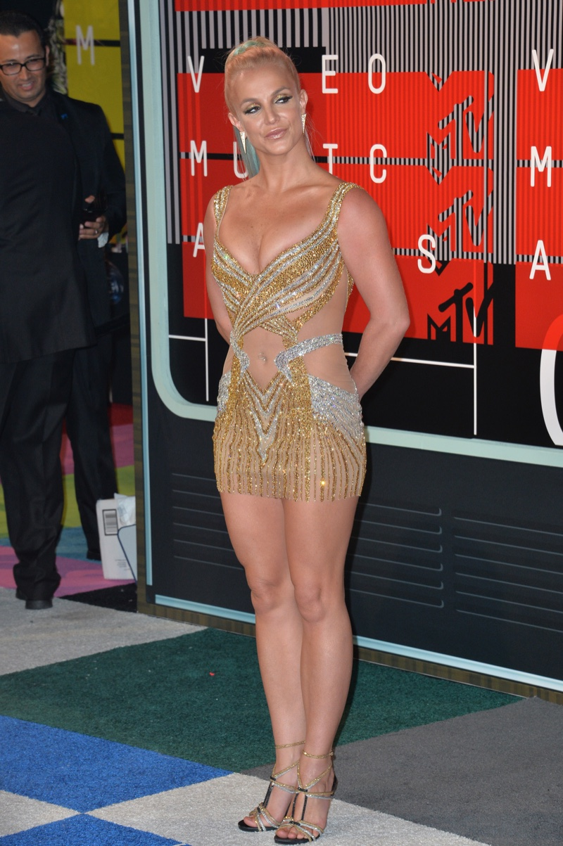 Britney spears attends the 2015 MTV Music Video Awards wearing a  Labourjoisie gold and silver minidress Photo: Jaguar PS / Shutterstock.com