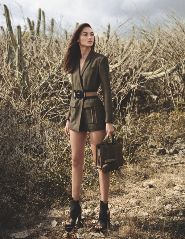 Bruna Tenorio models a Versace jacket and shorts