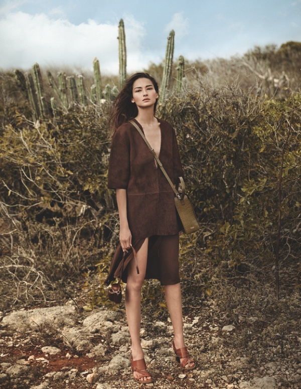 Bruna Tenorio poses in brown Michael Kors Collection top and skirt