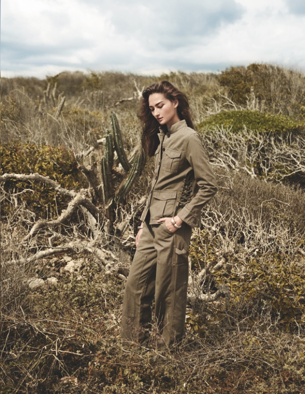 The model looks army chic in a khaki jacket and pants