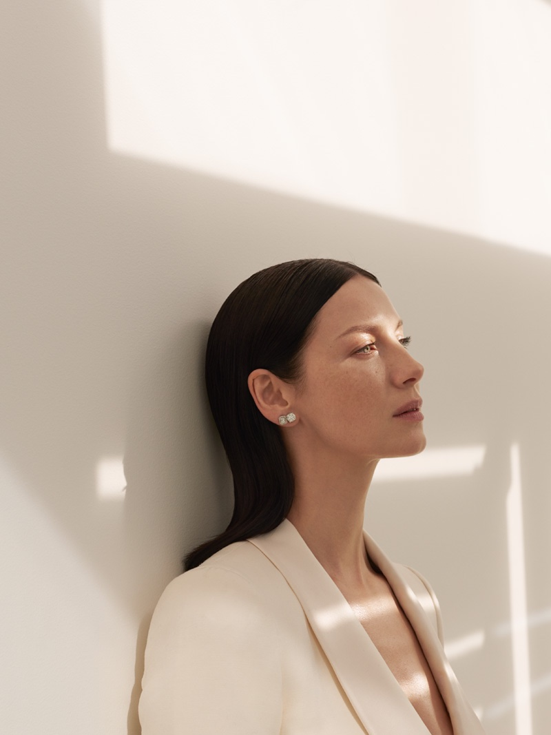 Captured in natural light, Caitriona modes a Bally blazer and Effy Jewelry earrings