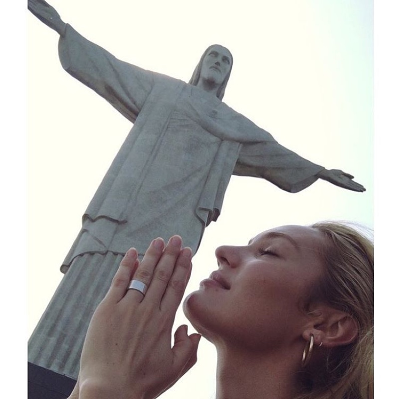 Candice Swanepoel poses in Brazil next to Christ the Redeemer. Photo: Instagram