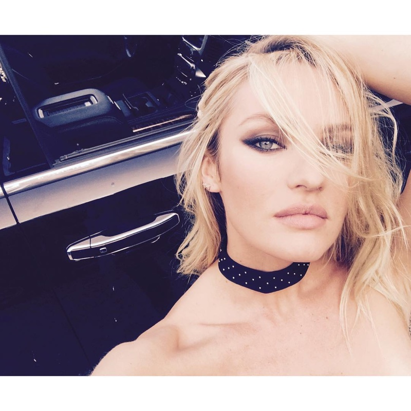 Candice Swanepoel shares a behind the scenes photo from an upcoming shoot wearing a choker necklace