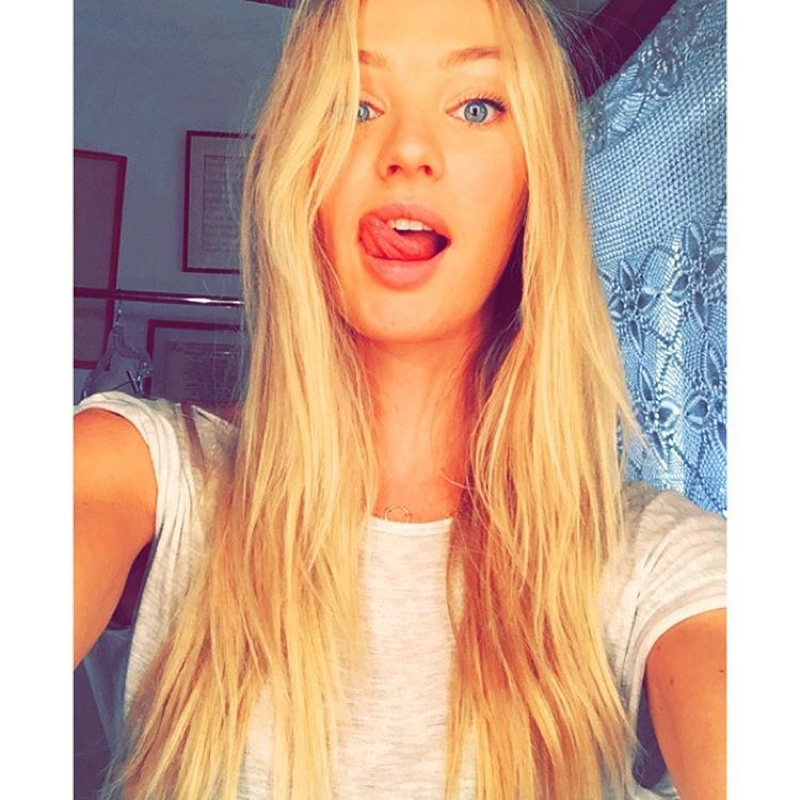 Candice Swanepoel sticks out her tongue in a fun Instagram snap.