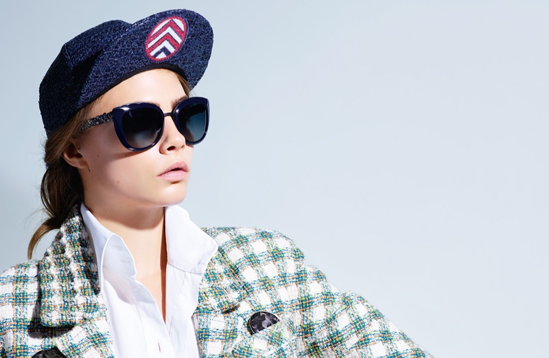 Modeling a tweed jacket and baseball hat, Cara Delevingne fronts Chanel Eyewear's spring 2016 advertising campaign