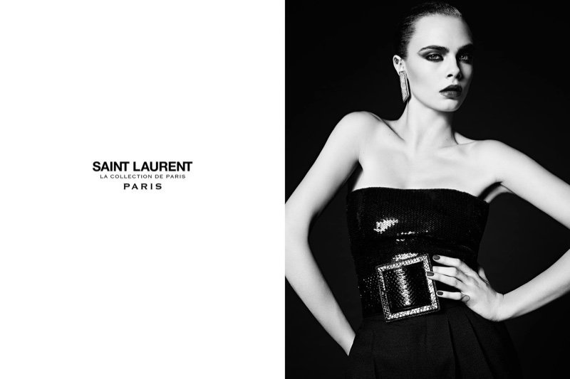Cara Delevingne poses in a strapless dress with an embellished belt for Saint Laurent's Paris campaign