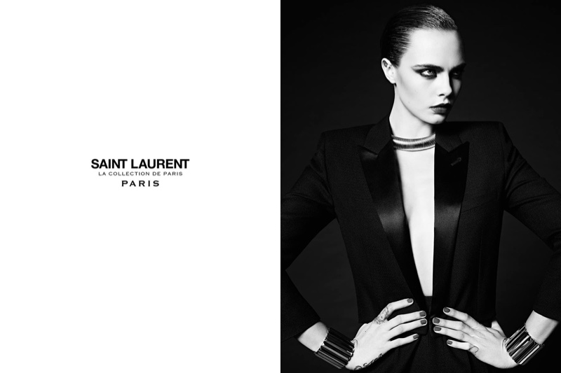 Posing with her hands on her waist, Cara Delevingne models a tuxedo jacket from Saint Laurent's Paris collection