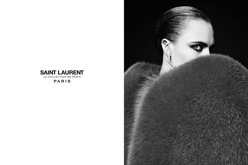 Photographed by Hedi Slimane, Cara Delevingne models a fur coat