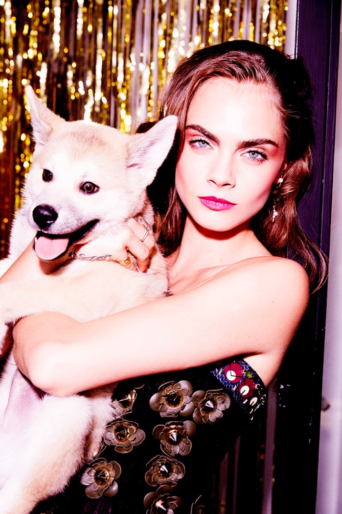 Photographed by Ellen Von Unwerth, Cara Delevingne poses with her new dog