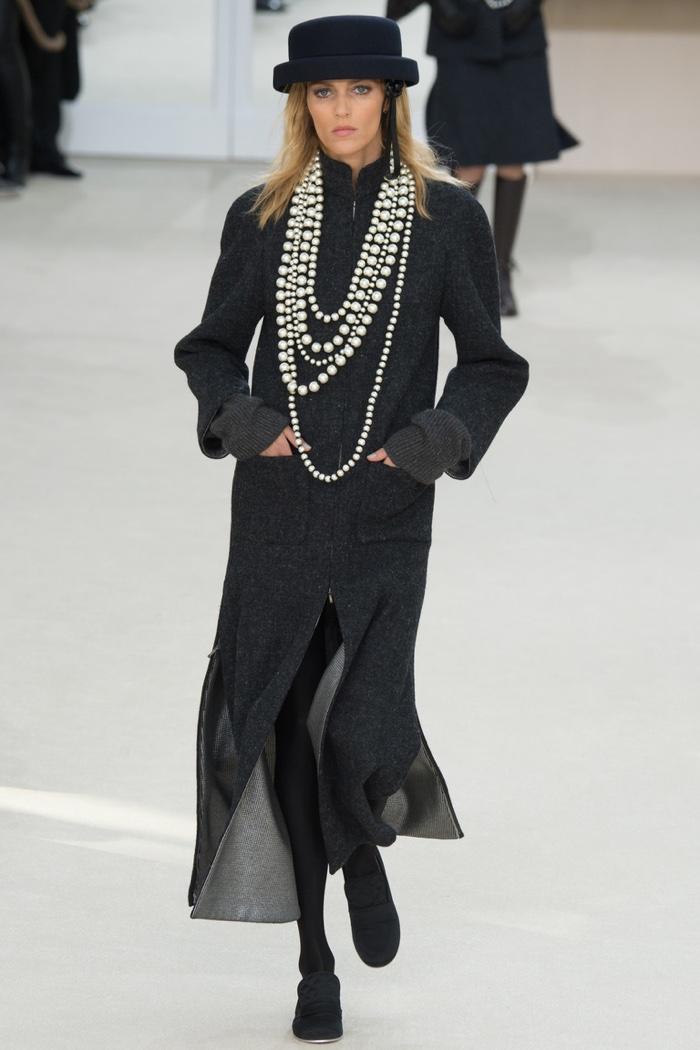 Anja Rubik walks the runway at Chanel's fall-winter 2016 show during Paris Fashion Week