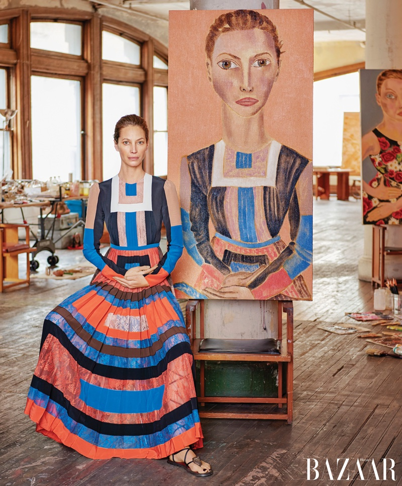 Christy Turlington poses next to Francesco Clemente portrait. Photo: Harper's Bazaar / Jason Schmidt