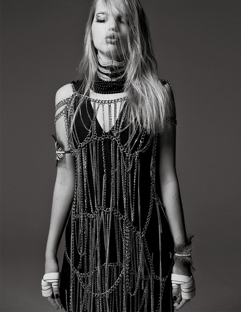 The blonde beauty gets covered in chains while wearing a MSGM dress