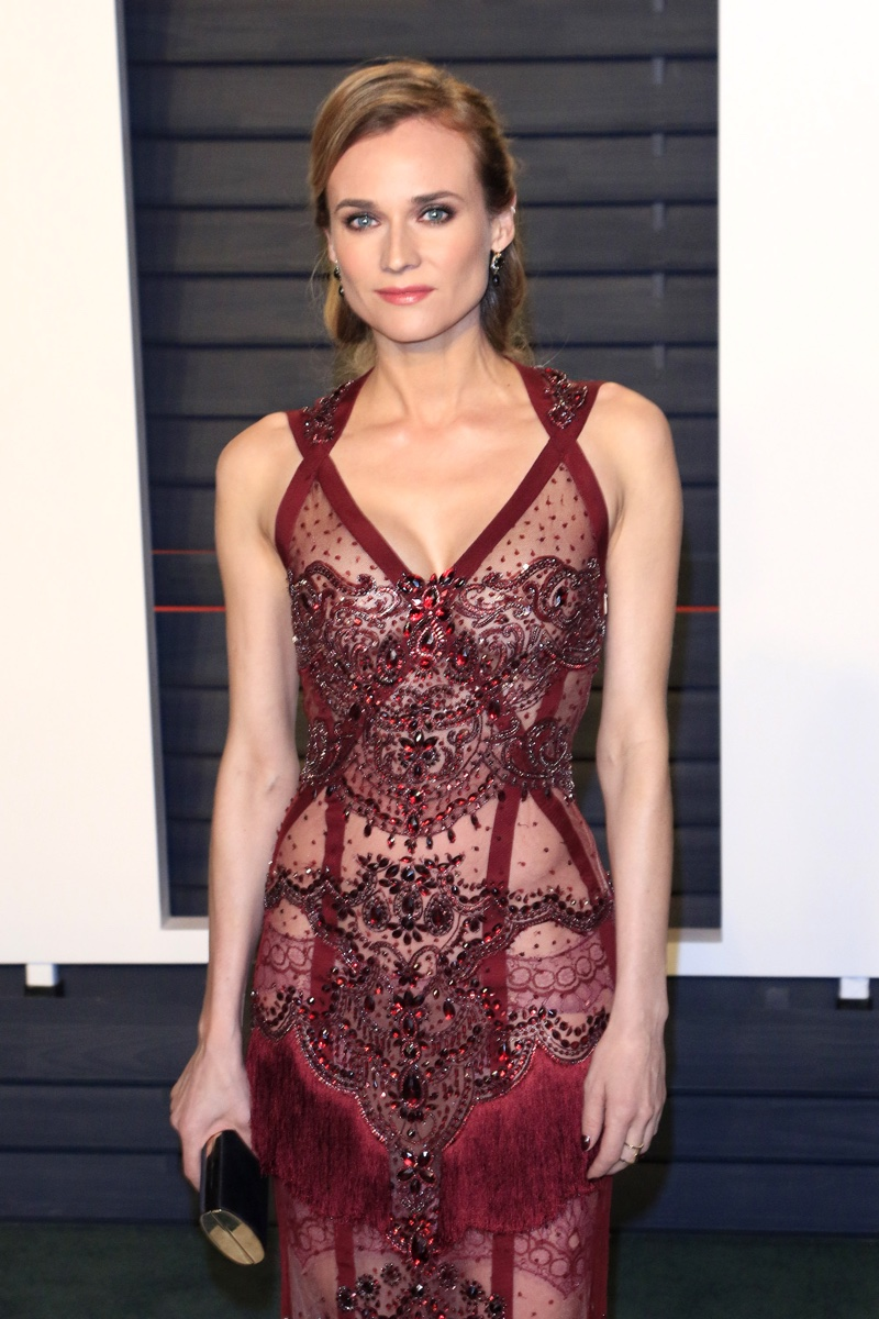 FEBRUARY 2016: Diane Kruger attends the 2016 Vanity Fair Oscar Party wearing a red Reem Acra gown with crystals. Photo: Joe Seer / Shutterstock.com