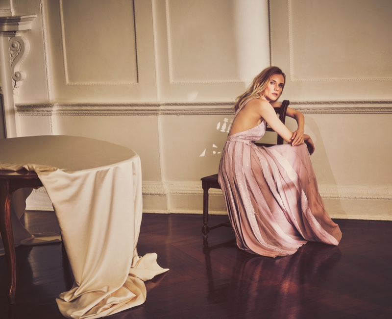 Sitting in a chair, Diane Kruger wears a pink Tibi maxi dress