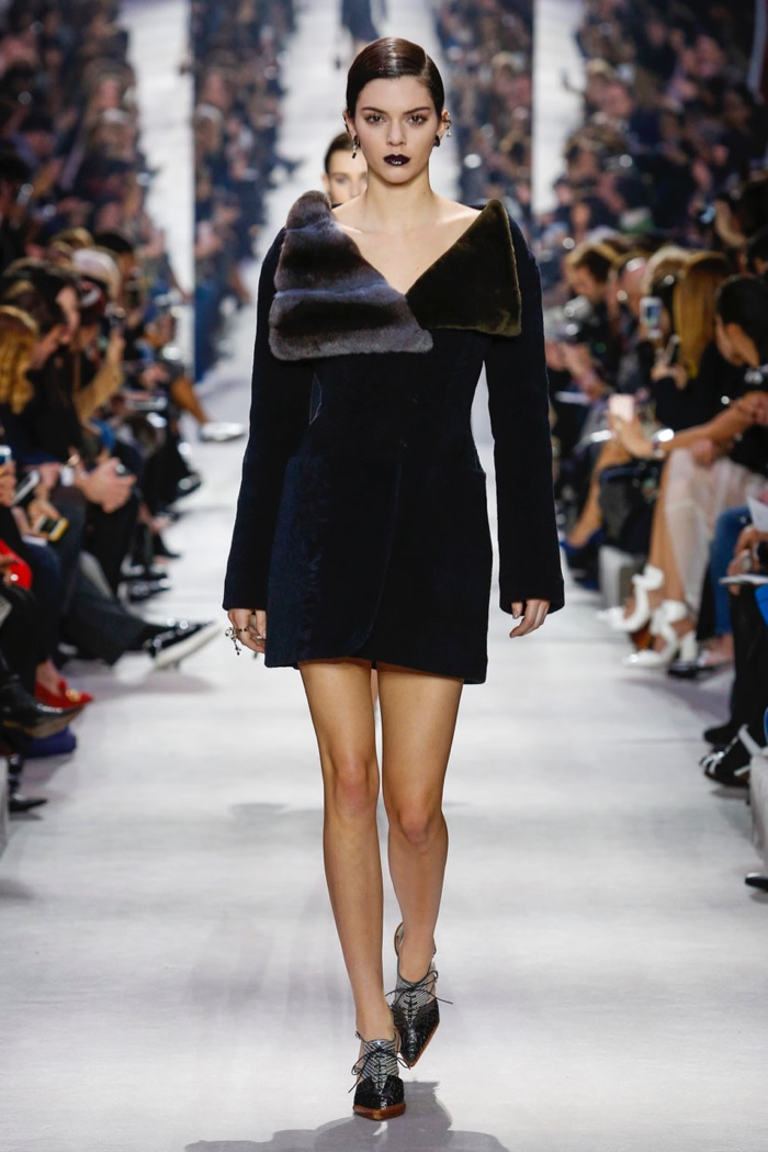 Kendall Jenner walks the runway at Dior's fall-winter 2016 show in a fur embellished dress