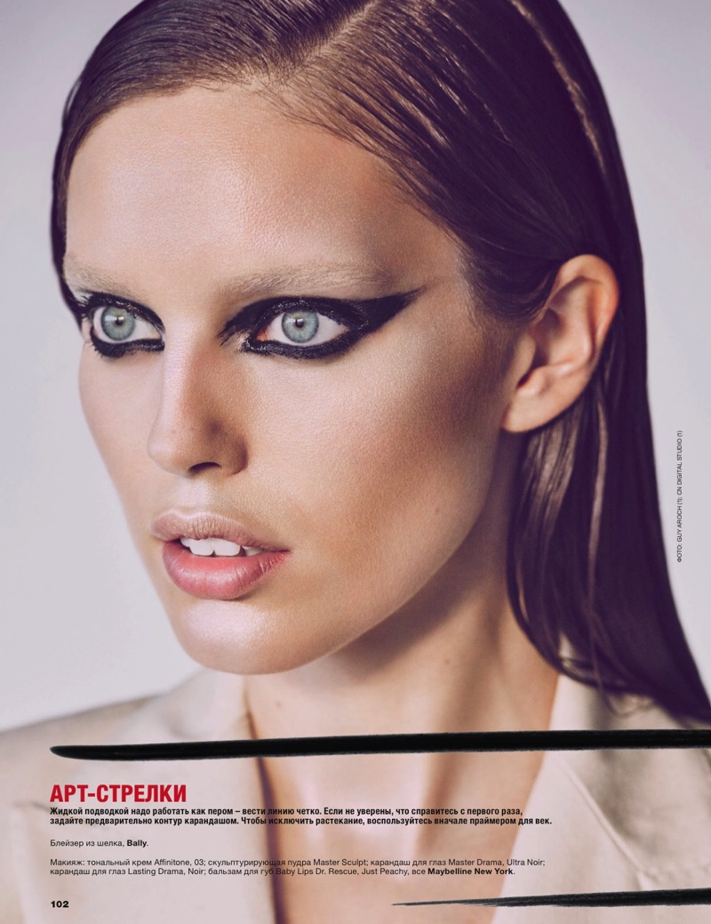 Emily DiDonato poses with winged eyeliner and a slicked back hairstyle for the beauty shoot