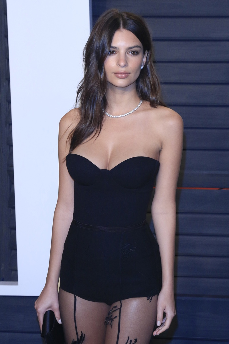 FEBRUARY 2016: Emily Ratajkowski attends the 2016 Vanity Fair Oscar Party wearing a Stephen Khalil black gown with a sheer skirt. Photo: Joe Seer / Shutterstock.com