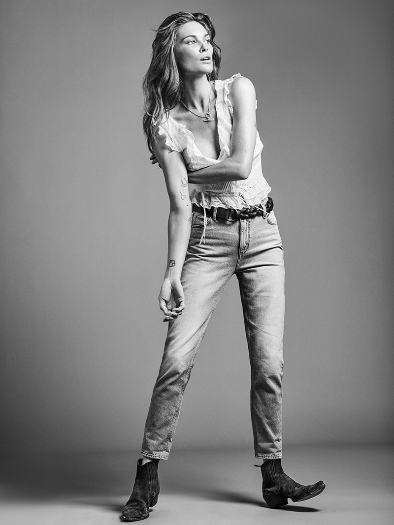Erin Wasson models a white tank top and jeans