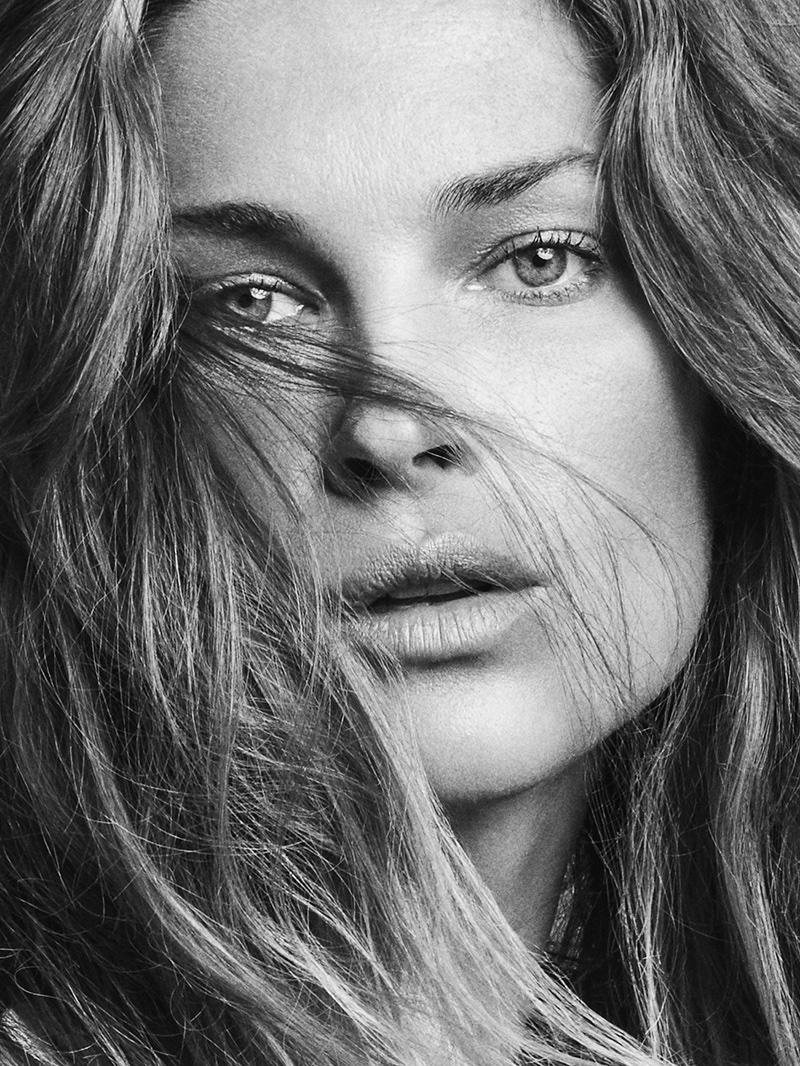 Wearing her hair in tousled waves, Erin Wasson poses for TELVA Magazine